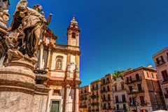 The obelisk-like Colonna dell Immacolata in the square San Domenico in Palermo, Sicily, Italy. The obelisk-like Colonna dell Immacolata, Immaculate Virgin with Royalty Free Stock Photos