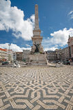 Obelisk in Lisbon during sunny day, Portugal. LISBON, PORTUGAL - APRIL 14, 2016: Obelisk in Lisbon during sunny day on Restoration square in honor of Portuguese stock image