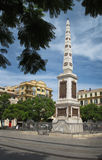 Obelisk Monument - Malaga Spain. Obelisk on place de la Merced in Malaga, Spain. This monument honors 49 victims in the fight for liberty in 1831 stock photo