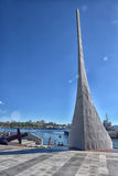 Obelisk Monument at Seawalk in Vladivostok, Russia. Stella in honor of the 125th anniversary of the city Vladivostok on the waterfront Ship stock image