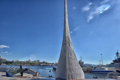 Obelisk Monument at Seawalk in Vladivostok, Russia. Stella in honor of the 125th anniversary of the city Vladivostok on the waterfront Ship royalty free stock images