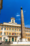 The Obelisk and the Palace of Montecitorio in Rome Royalty Free Stock Photography