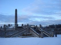 Obelisk in the snowy park. In Oslo Royalty Free Stock Photography