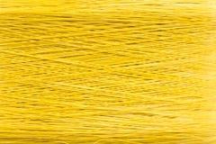 Oben geschlossen vom gelben Faden maserte Hintergrund stockfoto