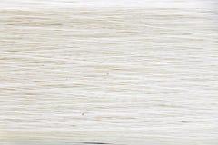 Oben geschlossen vom weißen Fadenbeschaffenheitshintergrund lizenzfreie stockbilder