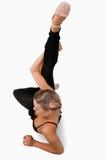 Obenliegende Ansicht des Ausdehnens des Tänzers Lizenzfreie Stockbilder