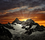 Ober Gabelhorn. Two peaks of the Swiss Alps and the sunset stock photos