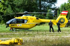 Oberammergau, Germany. 07.19.2018 15-10. An ambulance helicopter landed in a mountainous village in the field.  royalty free stock photography