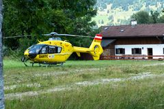 Oberammergau, Germany. 07.19.2018 15-10. An ambulance helicopter landed in a mountainous village in the field royalty free stock photos
