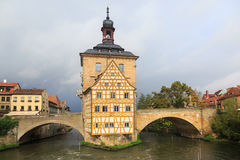 Obere bridge and Altes Rathaus and cloudy sky in Bamberg, German Stock Image