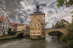 Obere bridge and Altes Rathaus and cloudy sky, sepia Stock Photography