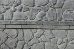 Oberfläche der Betonmauer mit Stein mögen Muster Stockbild