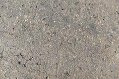 Oberfläche des alten Asphalts in der Landschaft für Hintergrund Stockbilder