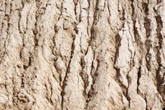 Sandoberfläche zur Wasserabnutzung Lizenzfreie Stockbilder