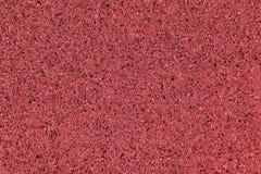 Oberflächensteinwand für roten Hintergrund Stockfotos