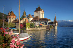 Oberhofen Castle on Lake Thun, Switzerland. Schloss Oberhofen is a romantic castle build on the Lake Thun (Thunersee) in Bern Canton of Switzerland. Parts of the Royalty Free Stock Images