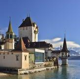 Oberhofen castle at the lake Thun, Switzerland. Schloss Oberhofen on Thun Lake, Switzerland Stock Photo