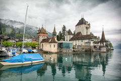 Oberhofen castle over Lake Thun in Switzerland Stock Images