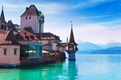 Oberhofen  castle. Panorama of Oberhofen castle in Switzerland with beautiful tower in standing in the lake Royalty Free Stock Photography