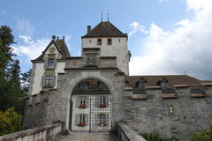 Oberhofen Castle. In Switzerland with a blue sky and clouds Stock Images