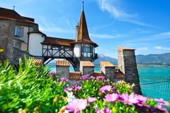 Oberhofen tower and flowers Royalty Free Stock Photography