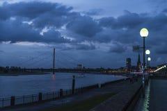 Oberkassel bridge at night in Dusseldorf, Germany Stock Photos