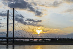 Oberkassel bridge at sunset in Dusseldorf, Germany Royalty Free Stock Photos