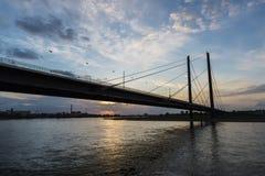 Oberkassel bridge at sunset in Dusseldorf, Germany Royalty Free Stock Image