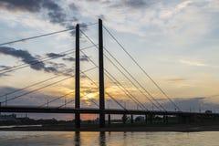 Oberkassel bridge at sunset in Dusseldorf, Germany Royalty Free Stock Photography