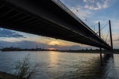 Oberkassel bridge at sunset in Dusseldorf, Germany Stock Images