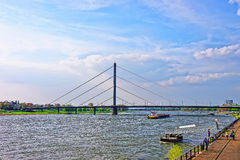 Oberkasseler Bridge and Rhine embankment promenade in Dusseldorf Stock Photo