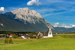 Obermieming Village and Mieming Range in Tyrol Austria. The Obermieming Village in Tyrol state, Austria with the peak of Hohe Munde 2662 m, Mieming Range or royalty free stock photo