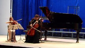 Oberon Trio. DNIPRO, UKRAINE - SEPTEMBER  26, 2016: Members of the Oberon Trio perform at the Philharmonic stock video footage