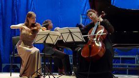 Oberon Trio. DNIPRO, UKRAINE - SEPTEMBER  26, 2016: Members of the Oberon Trio perform at the Philharmonic stock video