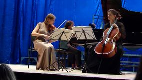 Oberon Trio. DNIPRO, UKRAINE - SEPTEMBER  26, 2016: Members of the Oberon Trio perform at the Philharmonic stock footage