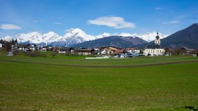 Town in Tyrol, Austria with mountains in the background stock image