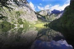 Obersee Lake reflections, Bavaria, Germany Stock Image