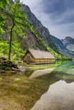 Obersee lake at spring and small wooden cottage, Alps Stock Images