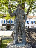 Bronze Wilde-Maendle statue or statue of the Wild Man on a sunny summer day in Oberstdorf, Germany stock photography