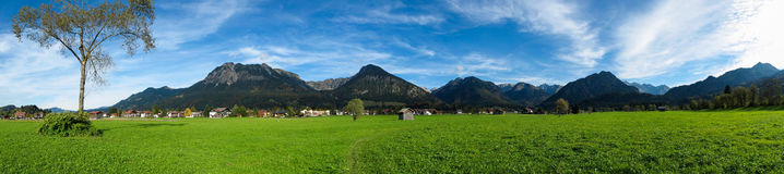 Oberstdorf with green fields Royalty Free Stock Photo