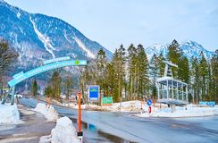 Vintage cabin in Obertraun, Salzkammergut, Austria. OBERTRAUN, AUSTRIA - FEBRUARY 21, 2019: The road intersection with signpost to Dachstein-Krippenstein cable stock photos