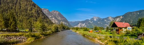 Obertraun, a small village in Austria. Obertraun village in Austria with mountains, river and beautiful houses royalty free stock images