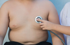 Obese asian boy check heart by stethoscope stock image