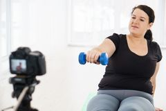 Obese blogger create video for weight loss blog. Fitness trainer, internet sporting class, training online video course. overweight blogger create video for stock image