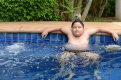Obese boy relaxing enjoying hot tub. Bubble bath outdoors on summer vacation travel holiday, relaxation concept stock image