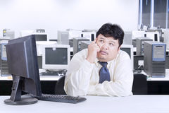 Obese businessman working in the office Royalty Free Stock Photography