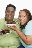 An Obese Couple Holding Plates Of Pastries Royalty Free Stock Images
