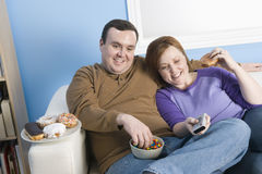 Obese Couple Sitting Together Royalty Free Stock Images