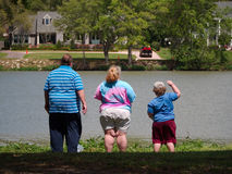 Obese family. BATON ROUGE, LOUISIANA - April 2015: Obese family stand by a lake stock photography