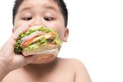Obese fat boy eat hamburger. Stock Photo